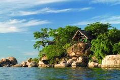 Mumbo Island is a pristine and deserted tropical island floating on the expansive waters of the Lake Malawi National Park. Adventure Tours, Adventure Travel, Amazing Places On Earth, Romantic Places, Luxury Holidays, Turquoise Water, Luxury Travel, The Good Place, Tourism