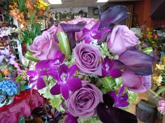Bridal bouquet of green Hydrangea, lavender Roses, Eggplant Calla Lilies, and purple Dendrobium Orchids. Designed by China Rose Florist, Marco Island, Fl.