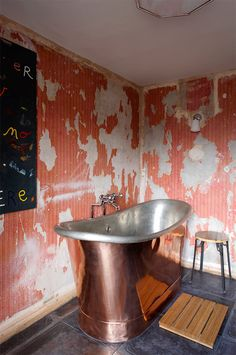 Distressed wall and copper tub