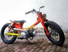 Cub custom with gas shocks and black rims
