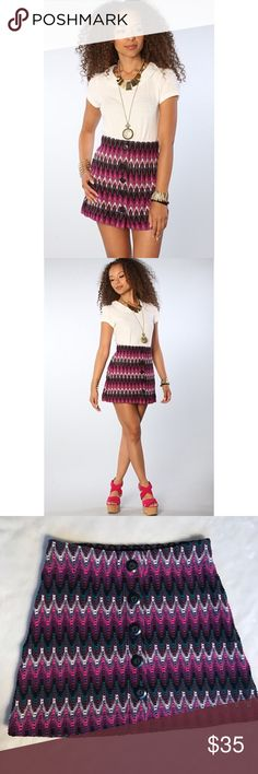 Free People knitted chevron mini skirt Free People mini skirt in a multicolored chevron print. Big buttons. You need a slip as you can see between the knit. Would be super cute with a long dress , skirt over, and knee high boots. Free People Skirts Mini
