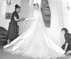 Audrey Hepburn is fitted in her wedding dress at the Italian fashion house of Sorelle Fontana in Rome, 1954