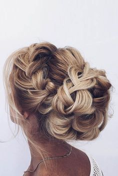 braided wedding hair updo ideas via ulyana aster