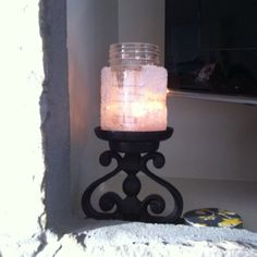 Used an old spice jar decorated to make candle holder