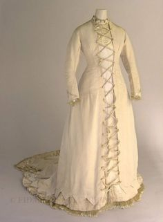 From FIDM Collections. Title:      Wedding Gown  Date:      c. 1877–1878  Material:      Silk/Cotton