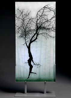 Dancer in the Mist: Paul Messink: Art Glass Sculpture - Artful Home Glass artist Paul Messink creates multi-layered glass panels that reflect the natural world and exhibit incredible dimensionality. Messink's panels are made of layers of glass which are stacked together, then fused into a solid piece. Portions of each image are hand-painted onto individual layers of glass with glass enamel.