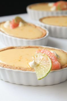 These bittersweet tartlets are made with refreshing grapefruit curd in tender brown butter tart shells and topped with soft cream. Grapefruit Recipes Dessert, Grapefruit Tart, Coulis Recipe, Curd Recipe, Butter Crust, Butter Tarts, Sweet Recipes, Pie Recipes, Tart Dough