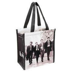 The Beatles Insulated Shopper Tote 72074 Insulated interior keeps contents cool or warm Secure Velcro closure Measures 9 x x 10 Inch Wipe clean with a damp cloth Ideal gift for the Beatles fan in your life Insulated Lunch Bags, Reusable Tote Bags, Amazon Price, Shopper Tote, The Beatles, Leather Shoulder Bag, Purses, Contents, Rockers