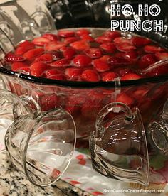 Ho Ho Punch: 1 bottle of chilled champagne, 1 bottle of chilled ginger ale, and 2 packages of frozen strawberries, partially thawed. Easy!  I made this once and called it Bitch Punch.