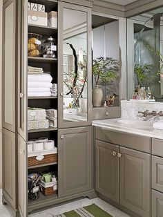 Hold everyday bath items, towels, and sheets in a built-in armoire that boasts floor-to-ceiling shelves. Keep everything neat and tidy within the mirrored cabinet by storing items in labeled boxes and bins.