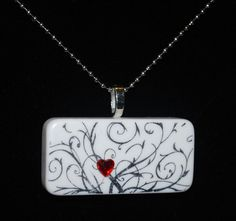 Love this! Red Heart Gemstone on an Elegant Swirled Background - Domino Necklace - FREE Shipping. $12.95, via Etsy.
