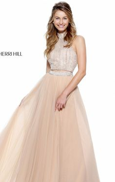 Let your beauty stand out in Sherri Hill 50786. Heavily beaded bodice in intricate pattern encrust the crop top.