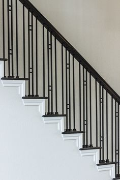 This design was created with the Aalto series plain bar (16.2.1) and the double bar balusters (16.6.1). These components are made of hollow wrought iron, and are available in a Satin Black (shown) or Ash Grey powder-coated finish. We offer parts, install services, and custom components throughout Texas. Click the image for more information.