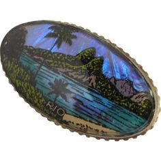 Vintage Mid Century Morpho Butterfly Wing Brooch Pin with a scene of a Palm Tree, Sand, Water and Mountain.   A genuine Morpho Butterfly Wing is