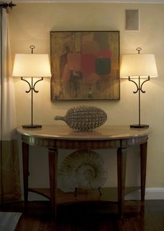 Entryway.. table and lamp.. No sea shell stuff