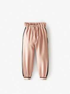Jogging trousers with an elastic drawstring waistband. Featuring printed side stripes and cuffed hems. Girls In Leggings, Girls Pants, Casual Fall Outfits, Kids Outfits, Zara Portugal, Stylish Hoodies, Girl Bottoms, Girl Online, Skinny