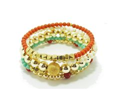 Multi-strand stack bracelets with turquoise color bead and gold beads (SU04B5). $26.00, via Etsy.