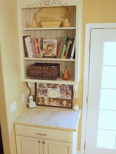 """I'm thinking you could make this with one plain 15"""" cabinet (remove door), paint it and add beadboard to the back and decorative molding on top with the shelf brackets underneath and BLAMO you have a message center/foyer cabinet next to the door!"""
