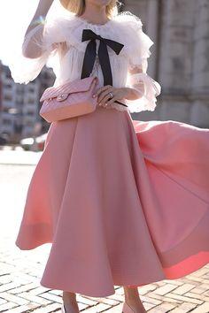 Skirt: Roksanda. Top: Storets. Bag: Chanel. Hat: Gucci. Sunglasses: Illesteva. Flats: Chanel