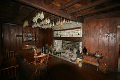 My dream kitchen--dark wood and a huge fireplace to cook in :)