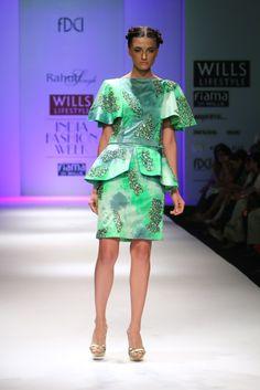 #wifw #wlifw #wifwss15 #fdci #fashionweek #RahulSingh #designerwear #weheartit #green #peplum #prints #sheer #sheergoodness #shimmer #embellishment #pink #stripes #asymmetrical #gold #light