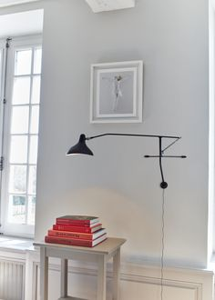The Mantis Wall Lamp by DCW éditions Paris strikes a balance between whimsy and practicality. This fixture boasts a thin steel body with full 360-degrees rotation from its base, while an intentionally misshapen lampshade acts as the head. The shade itself helps to create a focused and direct light wherever it's pointed. This piece is simple enough in an overall design that it can be easily affixed in most modern homes, functioning best in bedrooms or living rooms. Furniture Design Modern, Lighting Collections, Interior, Living Dining Room, Lamp, Modern Furniture Shops, Contemporary Furniture, Wall Lamp, Furniture Design