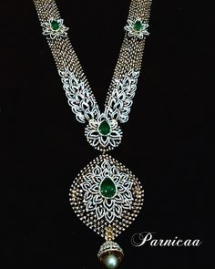 Royal wedding jewellery with huge diamond haarama with diamonds embossed all over.Huge emeralds placed inthe center of the dimond studded flowers on chain pattern and pendant are highlight.The haaram has flowers and leaves with diamonds. Diamond Necklace Set, Diamond Pendant, Emerald Jewelry, Diamond Jewelry, Gold Jewelry, Bridal Jewelry Sets, Wedding Jewelry, Bridal Jewellery, Royal Diamond