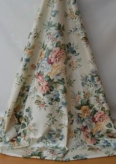 A Western textile screen print made in the USA, 100% glazed cotton floral design.