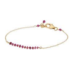 This elegant and feminine 14K gold filled bracelet is finished with a bar of gorgeous sparkly ruby-coloured Cubic Zirconia and gold beads.