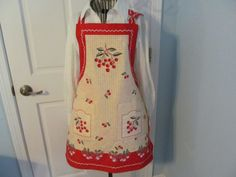 Cherries adorn this Reversable apron. with by KaTerryTheSewSisters, $25.00