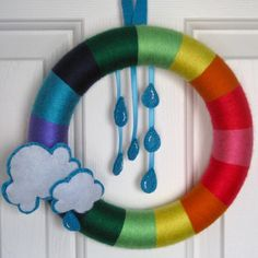 rainbow wreath - would be fun to do this, with different attachments a kiddo could switch out to match the daily weather