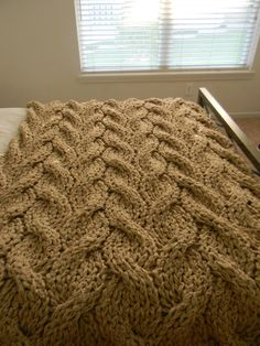 """I want to redo our bedroom and would love to make a big chunky blanket to throw across the bed.  The """"Lost in You"""" Chunky Knit Blanket pattern."""