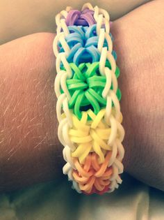Rainbow patterned rainbow loom bracelet that @Penny made for me! I LOVE IT!