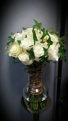 Ivy Bound Bouquet: White Roses accented with Ivy and Handtied with Curly Willow Vine.  Designed by Ms Scarlett's Flowers