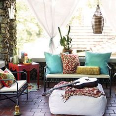 I like the stone on the porch walls and columns, the metal furniture works well with it and the fabrcis soften up the whole look.