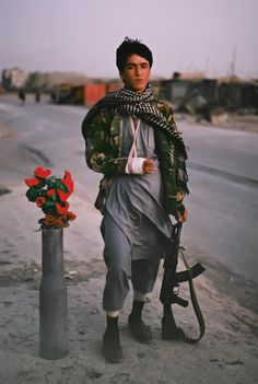 Steve McCurry- A child soldier poses for a photograph, in Kabul, Afghanistan.