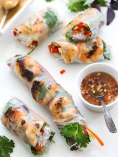 Grilled Shrimp Vietnamese Spring Rolls with Hoisin Peanut sauce and Nuac Cham dipping sauce ; mint ; basil ; cilantro cucumber ; carrot ; greens ; healthy ; Asian appetizer ; grill ; barbecue ; cookout