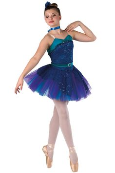 Style# 17332 MOON RIVER Teal spandex and royal sequined stretch lace leotard with attached top skirt and adjustable nude elastic straps. Separate matching belt and purple over jade chiffon tutu. Sequin braid and rhinestone buckle trim. Headpiece and ribbon for choker included. SC-XXLA