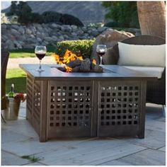 Ease into relaxation with this beautiful large firepit. Black tile and a porcelain steel bowl allows your guests to rest their feet, or use the space as the perfect place for drink and appetizers. Plus you can stow the propane tank inside the lattice enclosure. Price includes a protective vinyl cover. A very popular Propane Outdoor Fire Pit.  $599.95