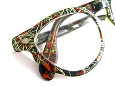 unique green snakeskin cat eye glasses. green, orange and gold texture with confetti and wings.