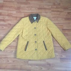 It is in great condition size medium body is polyester and nylon buttons are brown collar is brown lining is flowered  and all cotton