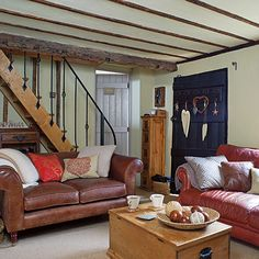 Since this cottage was built so long ago, you expect the rooms to be small and the ceilings quite low. The natural light is also at a premium here. In that case, the best you can do is paint everything, including the ceiling in a very light color.