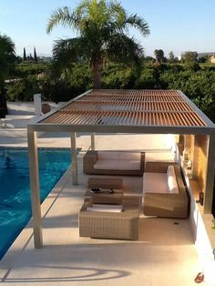 Modern metall pergola overlooking the swimming pool!