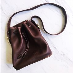 Vintage Coach Bucket Bag with Drawstrings FANTASTIC condition! Authentic Coach Bucky bag, gently used. Hardly any signs of wear, only a couple here and there. Adjustable buckles on both sides. Dark chocolate brown in color. Very rare! Ready for a new home! Coach Bags Shoulder Bags