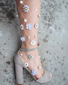 Lirika Matoshi Daisy white fishnet tights with flower beads, $150 (~£120 / ~141€)