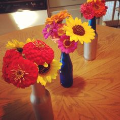 Spray paint old glass soda bottles for cheap and cute flower vases.  #DIY