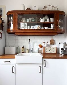 Gorgeous cabinet. Better than open shelving because your dishes stay cleaner. #kitchen