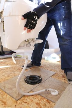 Removing the toilet in the RV before replacing the flooring | MountainModernLife.com