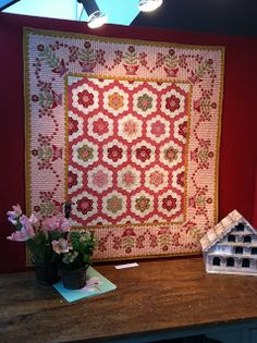 Maggie Grace's Garden by Di Ford. Charming hexagon center with applique'd border.