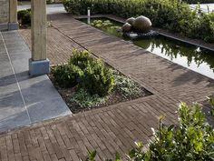 Classic brick with contemporary grey slabs. Garden Paving, Terrace Garden, Water Garden, Garden Landscaping, Outdoor Walkway, Contemporary Garden Design, Water Features In The Garden, Brick Patios, Yard Design